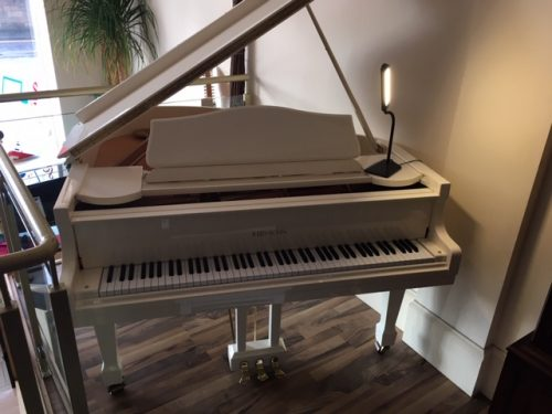 Reid Sohn White Grand Piano